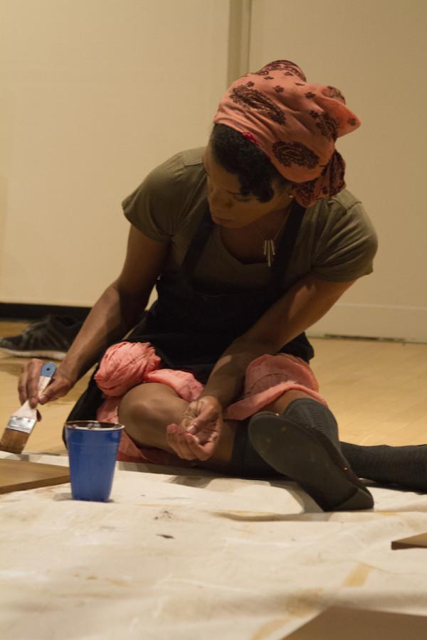 Junior Jasmine Smith helps paint part of the exhibit. The exhibit runs until Oct. 30.