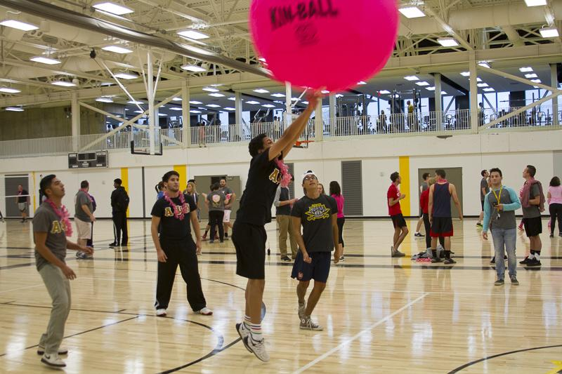 Students returning a serve