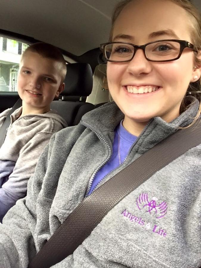 Justice with Jordan on their way to Skyzone (an indoor trampoline place). She goes with Jordan there as much as she can because he loves it.