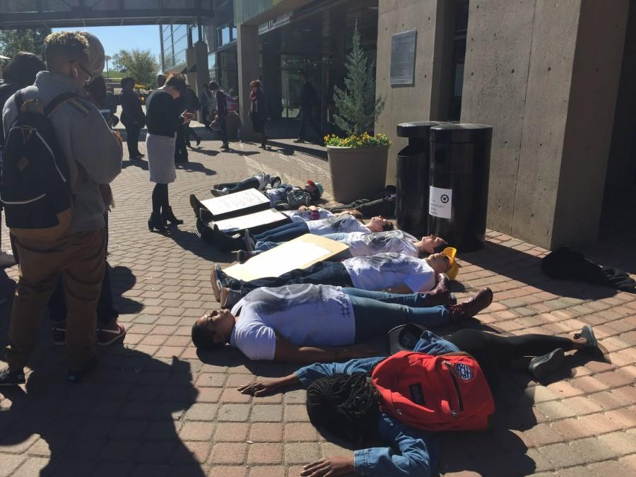 Students take part in a die-in during the silent protest bringing awareness to school shootings and gun violence. The protest was organized by Students for Social Change.