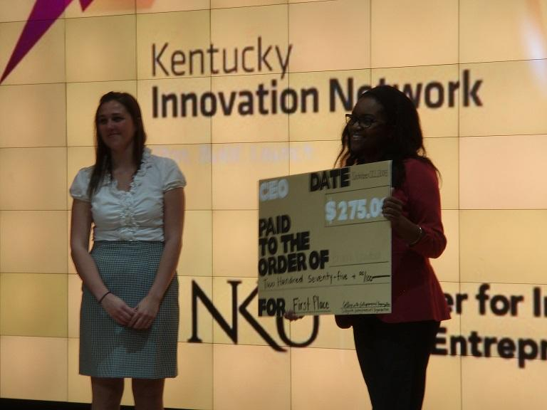 CEO President Samantha Pearson awarding first place Briana Crawford. The Collegiate Entrepreneurs' Organization held its first elevator pitch competition Thursday.