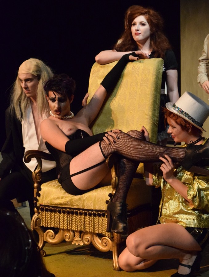 """Frank-N-Furter's opening song, """"Sweet Transvestite"""" comes to a close. Frank-N-Furter, who sits in the throne and is surrounded by his servants, is portrayed by Josh Newman in NKU's """"The Rocky Horror Picture Show"""" shadowcast production."""