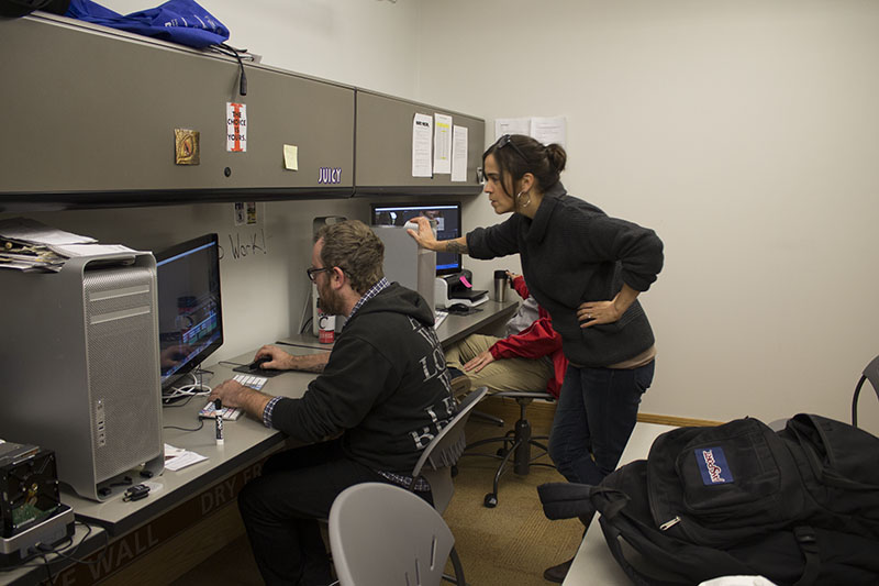 Sara Drabik works with student Holland Rains in the Norse Media office.