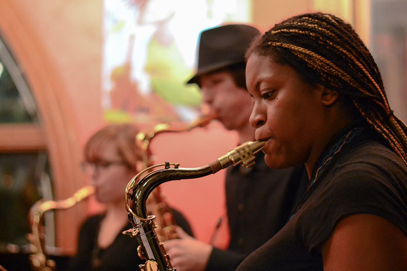Students play instruments in the cafe.  York Street Cafe hosts the jazz bands.