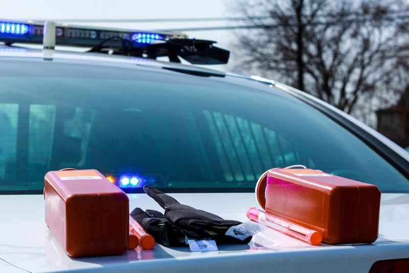 NKU officers keep needle-resistant gloves and various sizes of sharps containers in their cruisers. The gloves and strips containers protect them from blood-borne illnesses such as Hepatitis C.