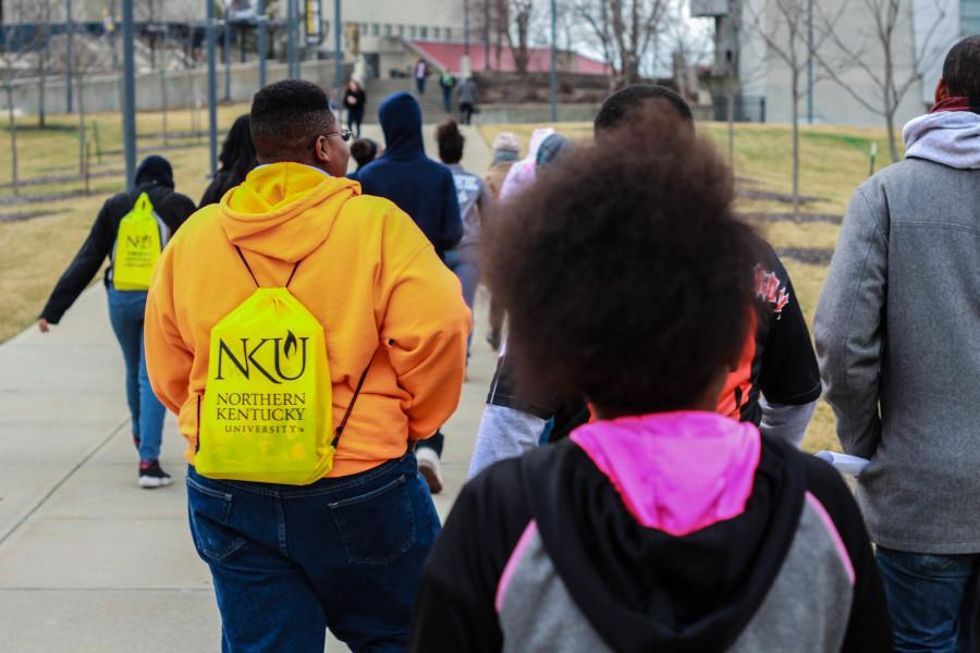 NKU student tour guide Faith Pearce talks to Withrow University High School eighth graders about NKU dormitories.