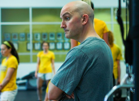NKU strength and conditioning coach Brian Boos oversees athletes lifting in the weight room.
