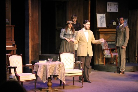 In this picture the characters are Eliza Doolittle played by Audrey Macneil, Henry Higgins played by Justin Woolums and Colonel Pickering played by Taylor Greatbatch. In this scene Higgins is telling Eliza she needs to get cleaned up.