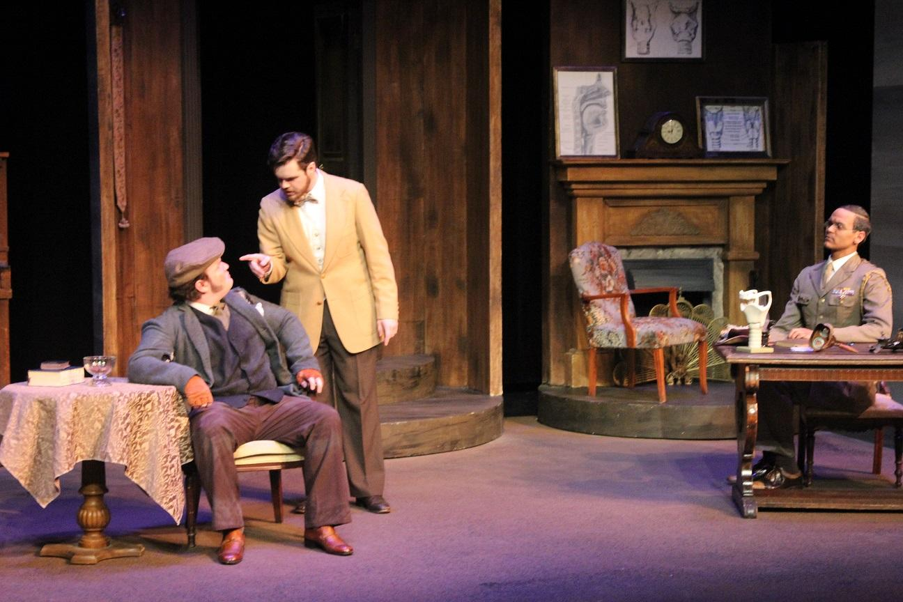 The characters in this scene are Henry Higgins played by Justin Woolums, Colonel Pickering played by Taylor Greatbatch and Alfred Doolittle played by Zach Robinson. This scene is when Alfred is trying to get Higgins to pay him five pounds.