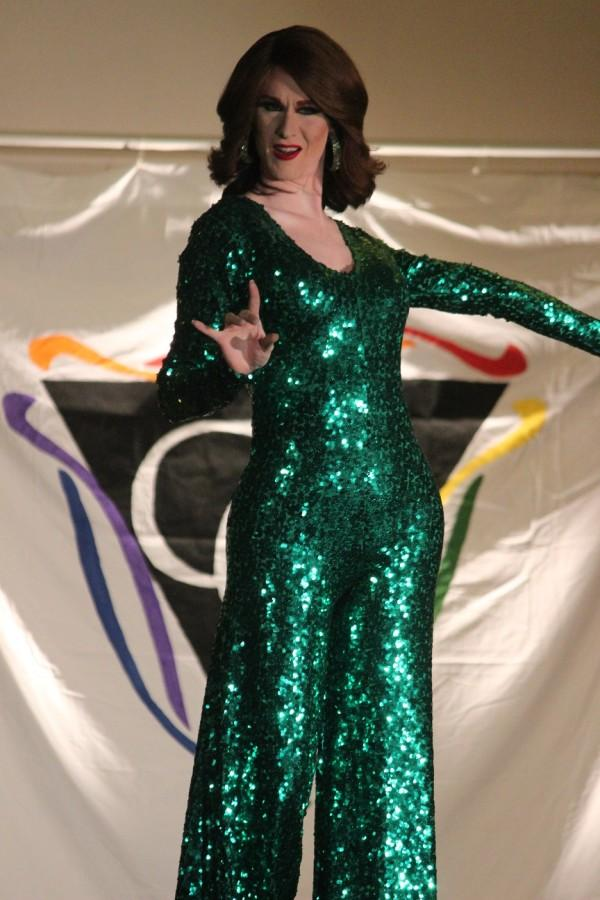 """Co-Hostess, Mirelle Jane Divine, performs in her bright green sequined """"late St. Patrick's Day"""" outfit."""