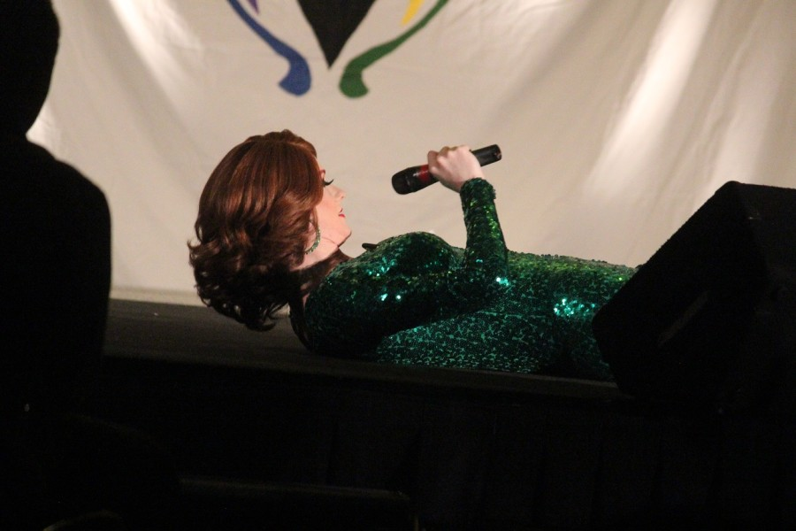 Mirelle Jane Divine lays on stage and waits for Crystyle Starr's next performance.