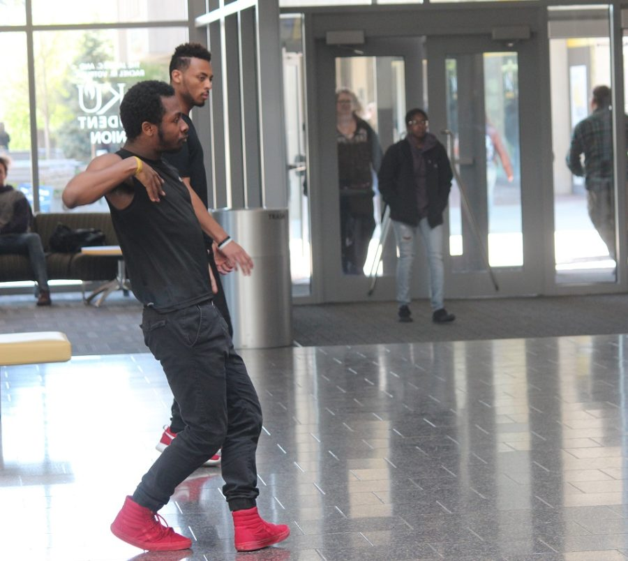 ENVI dance team floods on to the Student Union second floor performing several dance routines. Freshman dancers, Marquise Howie and Daante Bowman and reenact a dance battle between the other dance members.