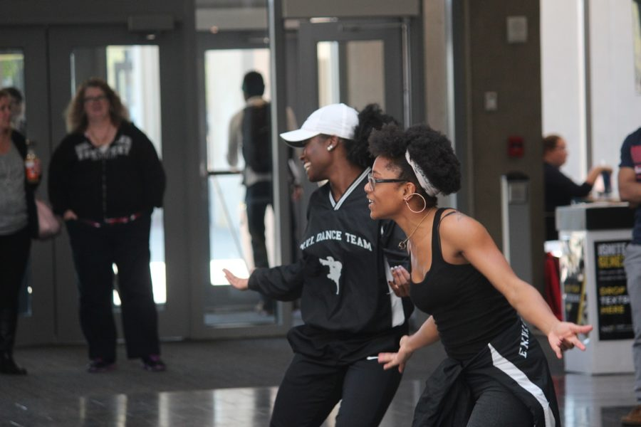 Seniors, Rhonisha Gentry and Valencia Stallings steps in the join on other side of the dance battle and hypes the crowd while getting ready to perform the rest of their routine.