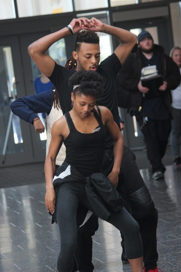 """Popping, two stepping and backing it up, Rhonisha Gentry and Daante Bowman, members of ENVI dance team, show the Student Union lobby what ENVI has to offer. """"We are trying to make ENVI something people all over campus know and want to see!"""" Daante Bowman said."""