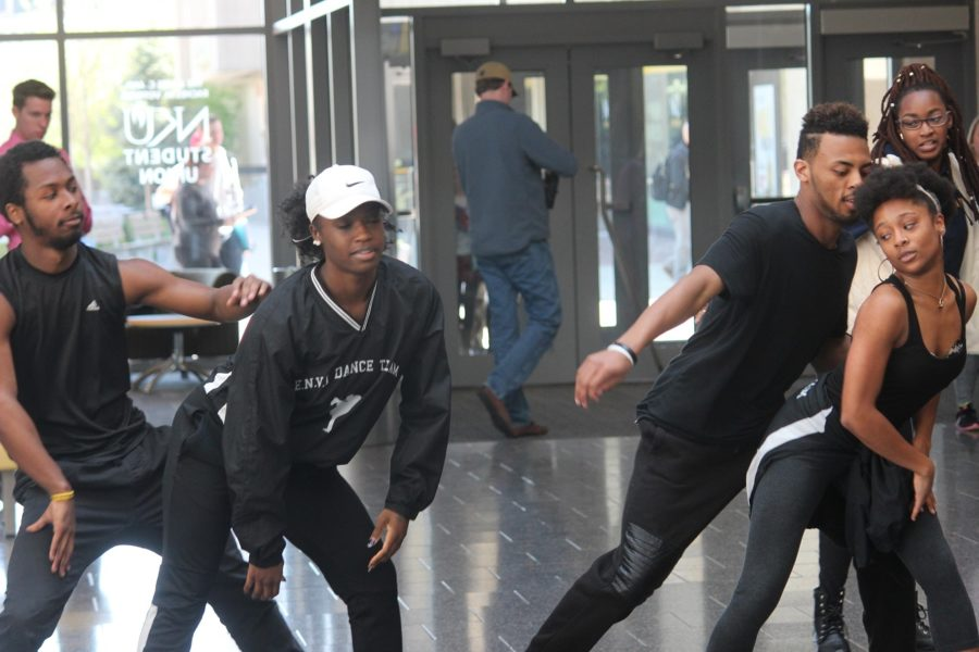 ENVI dancers flood into the Student Union hallway with a flash mob performance