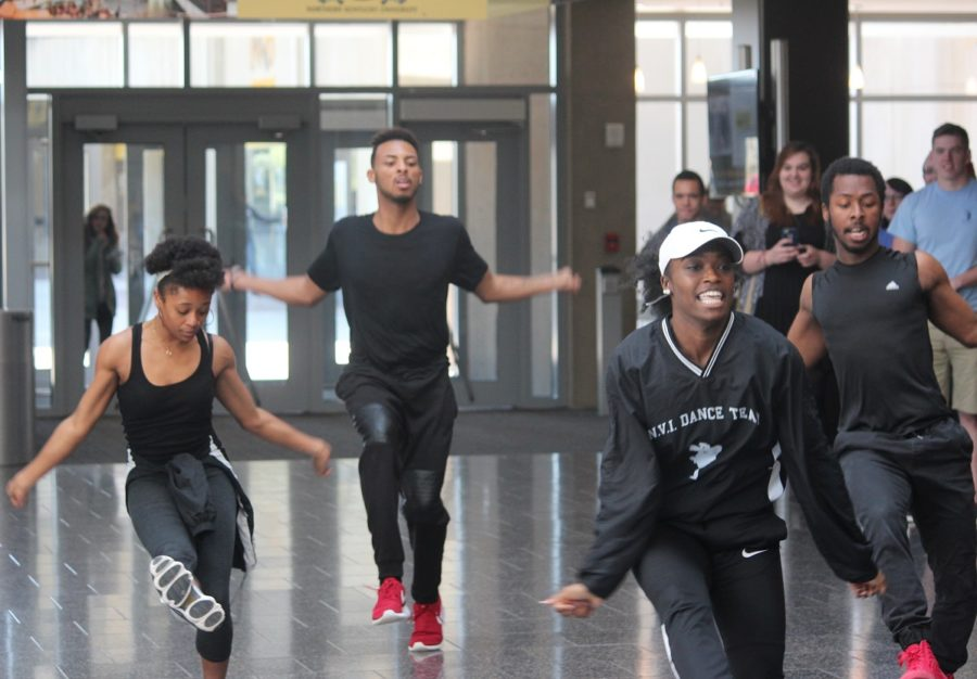 ENVI dancers flood into the Student Union hallway with a flash mob performance.