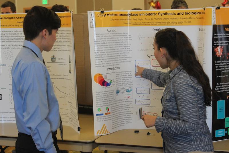 Alma Oñate, a senior at NKU, explains her research to crowd at the Celebration of Student Research and Creativity.