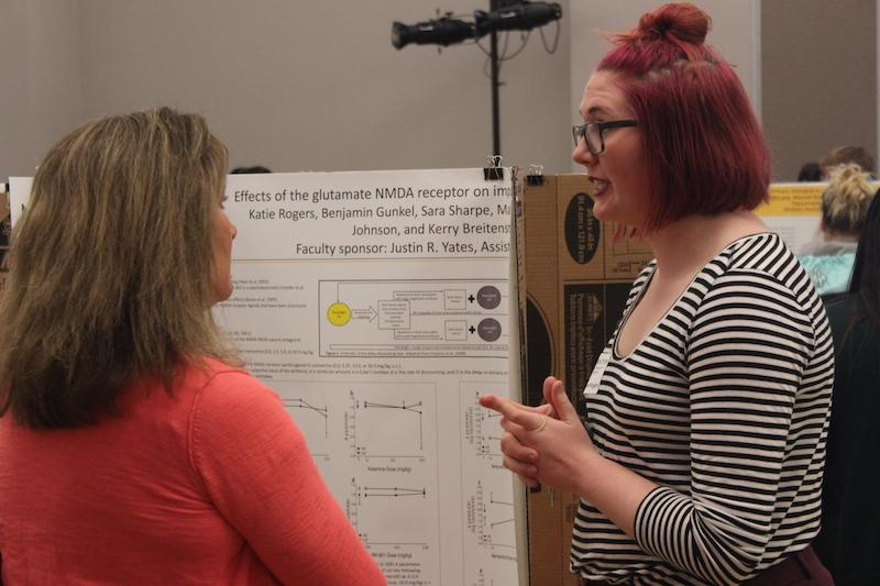 Katie Rogers, a senior at NKU speaks on her research at the Celebration of Student Research and Creativity Celebration.