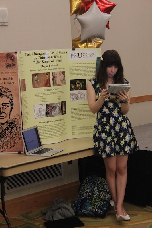 Kathleen Quinn, a senior at NKU, showcases her research on the changing roles of women in Chinese folklore.