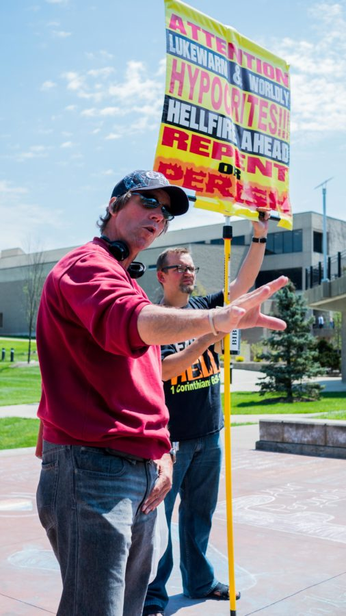 Toting signs with messages of condemnation, two street preachers spouted their message on campus April 20. The duo was set up in the amphitheater overlooking Loch Norse.