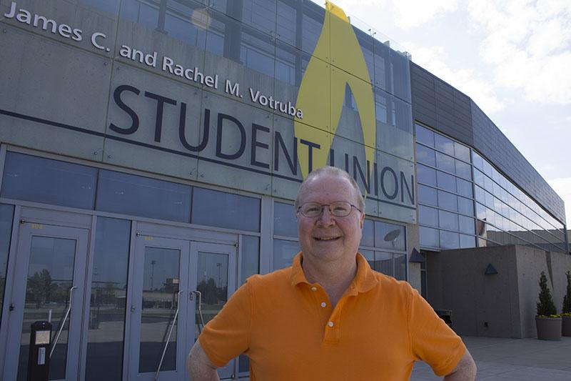 Dr. Proctor stands in front of the Student Union, which is named after one of his dearest friends, former NKU President James Votruba.