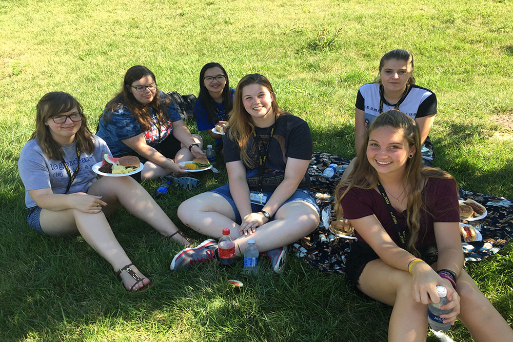 NKU's scholars discuss their experiences at the program's cookout.