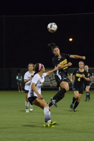 Katelyn Newton heads a ball up the field against Milwaukee. Newton and the Norse fell to the Panthers 1-0