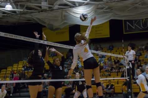 Haley Libs jumps to spike a ball past the Cleveland State blockers. CSU would go on to win the match 3-2.