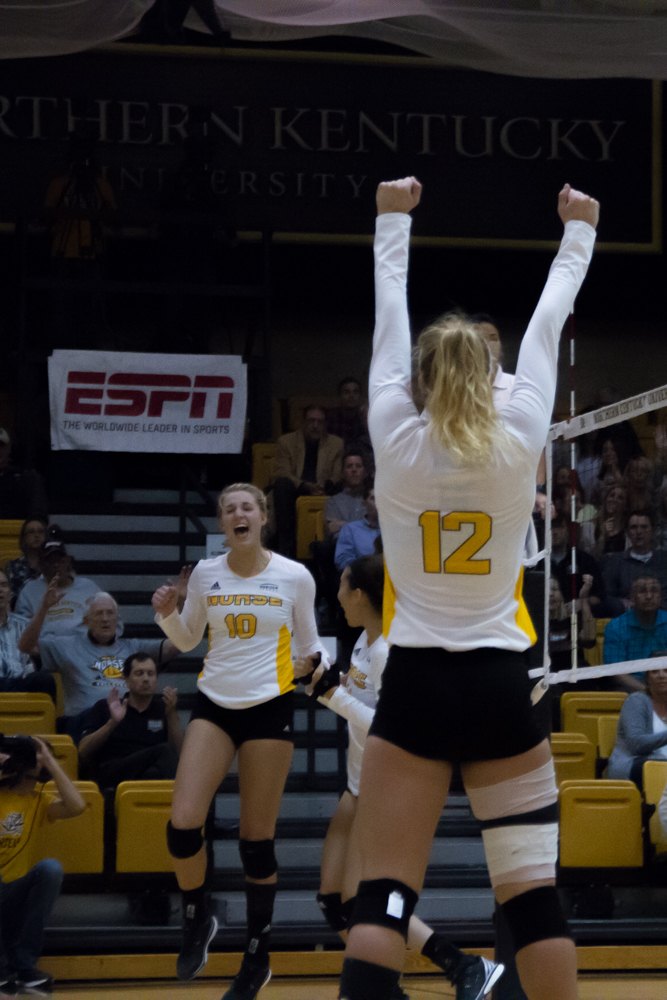 Laura Crawford and Tristen Simpson celebrate after earning a point. The Norse would lose to Cleveland State in five sets.