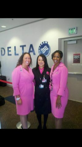 (From left to right) Niki Ross, Lori Hawkins-Gunn and Shanda Harris pose for a picture before working a Comair flight.