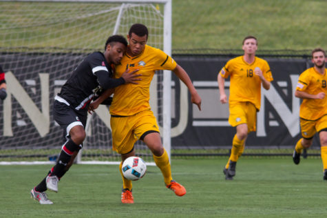 Kobie Qualah fights for the ball with a UC defender. The Norse tied with UC 0-0.