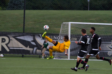 Alwin Komolong attempts a bicycle kick in Wednesday's game against UC.