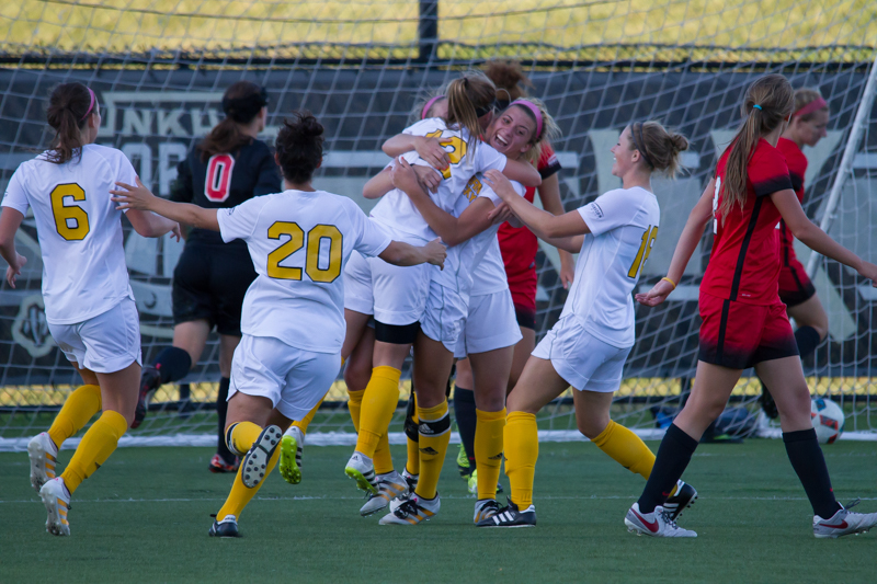 Macy Hamblin embraces Jessica Frey after Frey scored the game winning goal in the 80th minute.