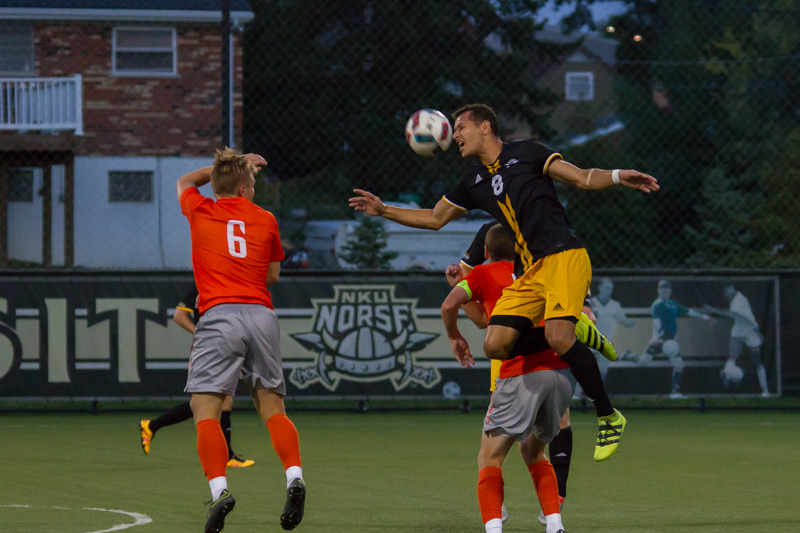 Alwin+Komolong+jumps+up+to+head+a+ball+against+the+BGSU.+The+Norse+would+lose+2-1.+