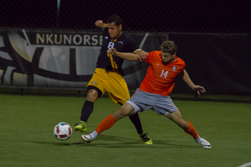 Alwin Komolong dodges a Bowling Green defender. The Norse lost to BGSU 2-1