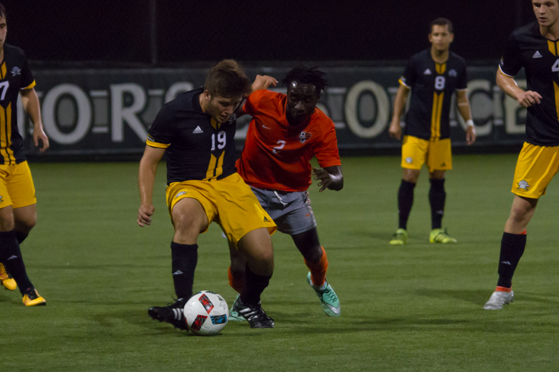Joey+Sabato+looks+to+pass+to+an+open+teammate+against+BGSU.+The+Norse+lost+2-1.