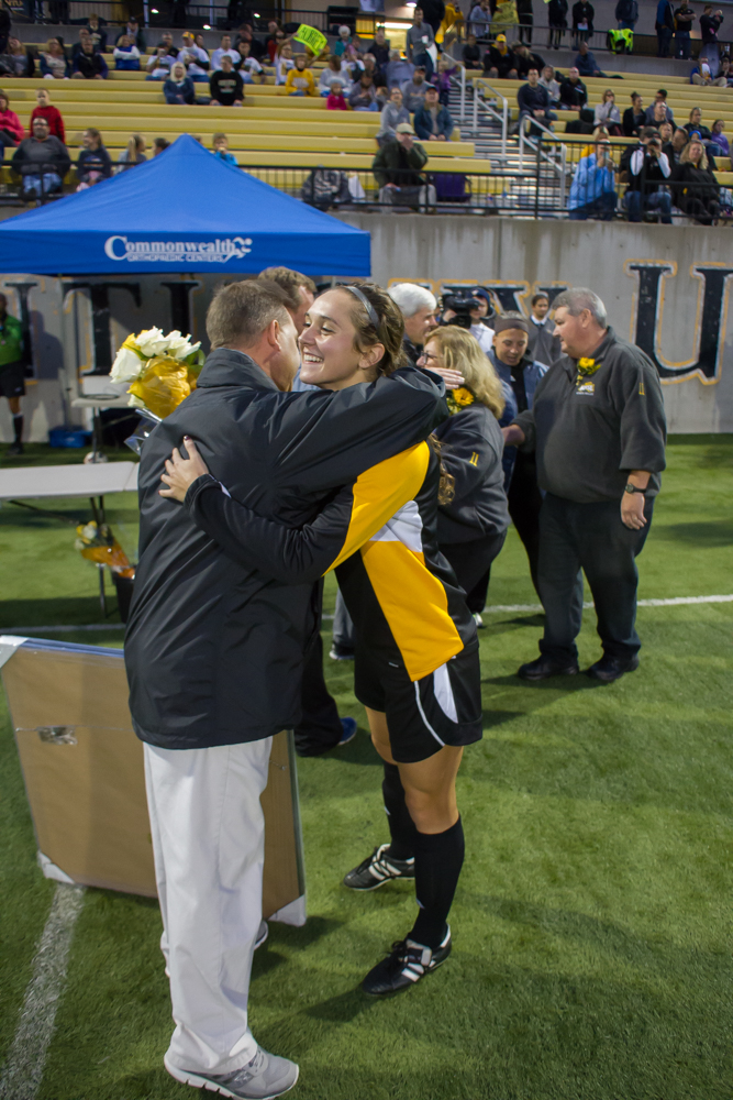 Senior Chrissy Spears shares a hug with head coach Bob Sheehan prior to Friday's game with Valparaiso.