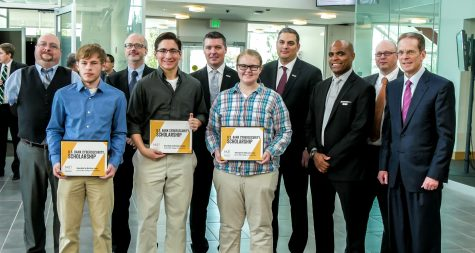 NKU students Nathanael Long and Nick Mester and Allyson Frame (front) received cybersecurity scholarships as part of a partnership between US Bank and NKU.
