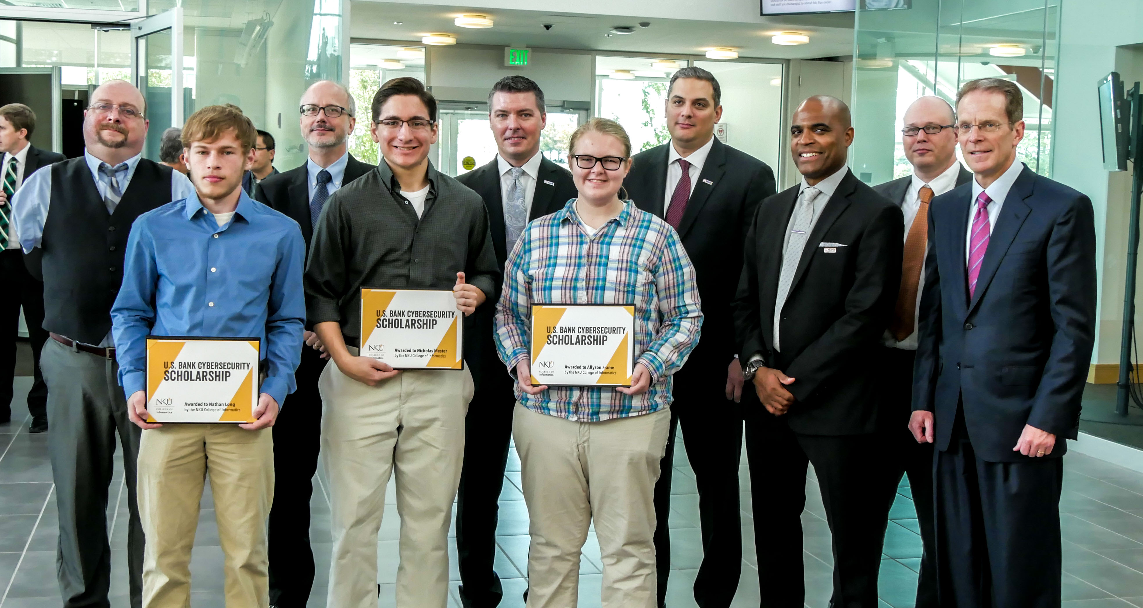 NKU+students+Nathanael+Long+and+Nick+Mester+and+Allyson+Frame+%28front%29+received+cybersecurity+scholarships+as+part+of+a+partnership+between+US+Bank+and+NKU.