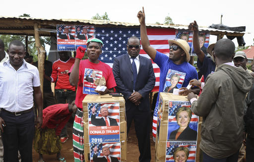 Comedians stage a mock election in the village of Kogelo, the home town of Sarah Obama, step-grandmother of President Barack Obama, in western Kenya, Tuesday, Nov. 8, 2016. Residents of the town made famous by its association with President Obama cast their votes for either Hillary Clinton or Donald Trump, with Clinton winning according to an organizer. (AP Photo)
