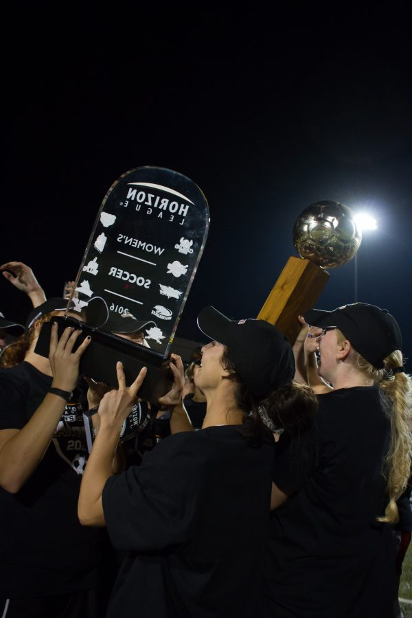 The NKU Norse hold up the Horizon League trophies after beating Milwaukee 3-2 in the championship game.