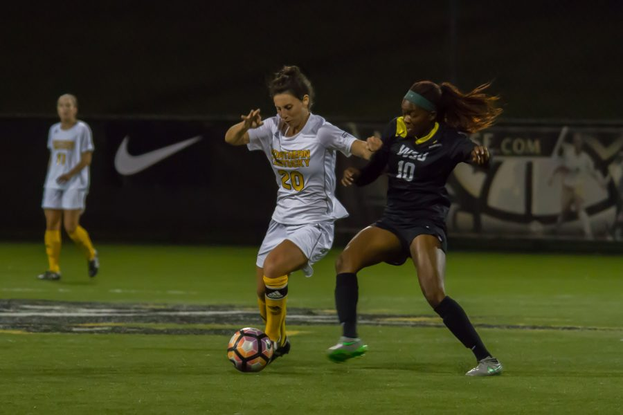 Katelyn Newton tries to dribble around a Wright State defender. The Norse beat the Raiders 1-0 in the quarter finals of the Horizon League tournament