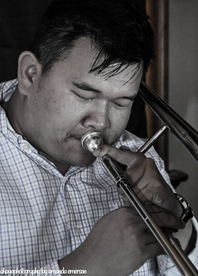 Justin Schmitt played his golden trombone. Along with 2 friends, Schmitt founded Clever Records.