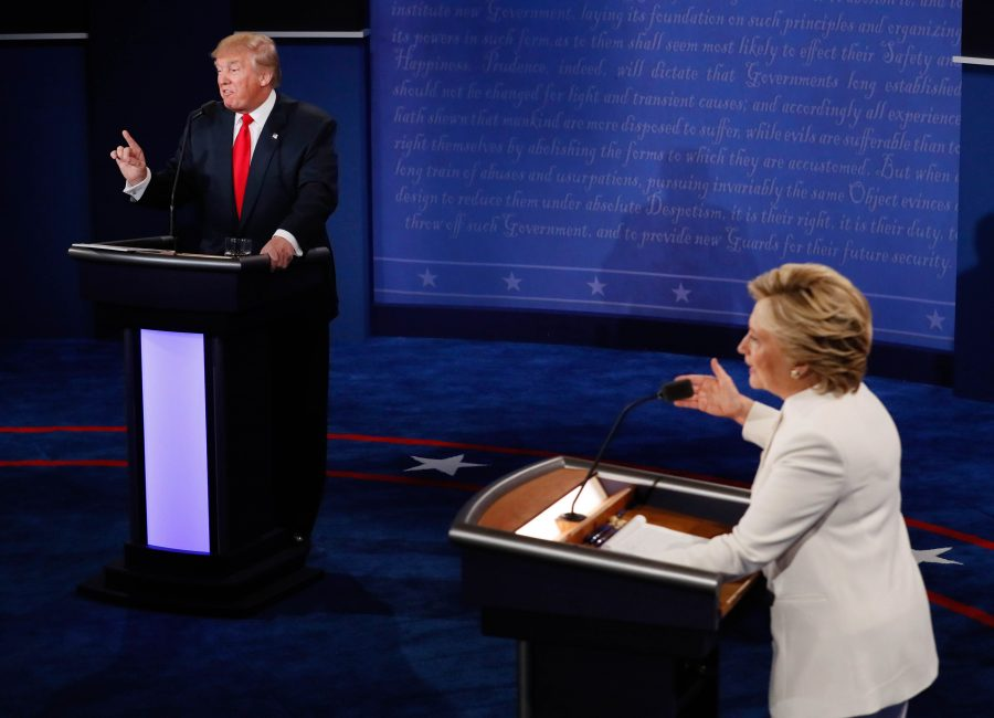 """FILE - In this Oct. 19, 2016 file photo, Democratic presidential nominee Hillary Clinton and Republican presidential nominee Donald Trump debate during the third presidential debate at UNLV in Las Vegas. Headed for history books, the duel between Hillary Clinton and Donald Trump became a battle of """"nasty women"""" and """"bad hombres"""" vs. """"deplorables"""" and voters who are """"irredeemable.""""  (Mark Ralston/Pool via AP, File)"""