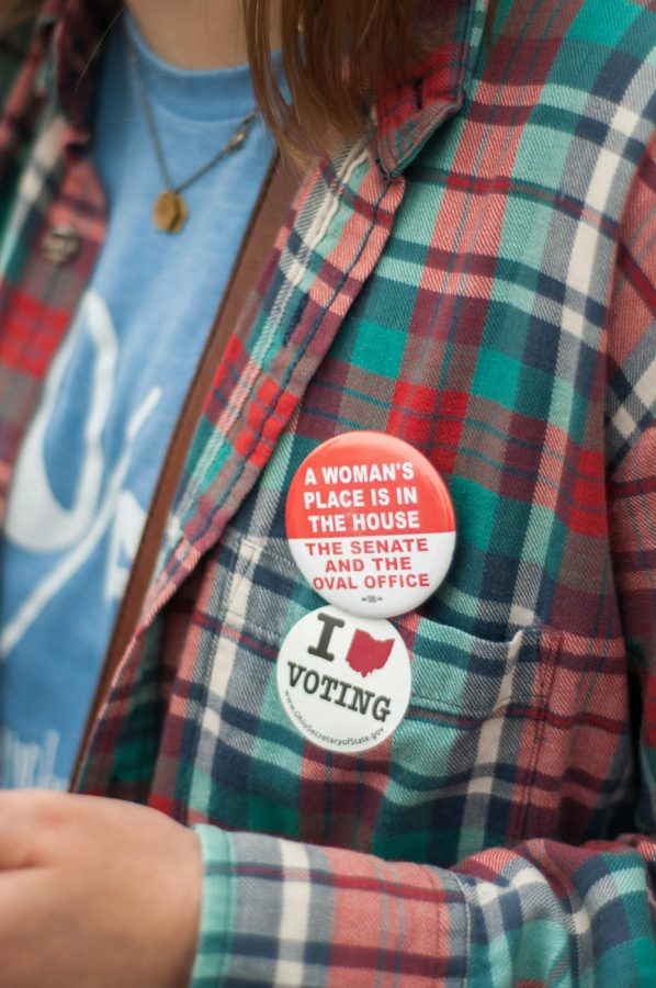 Kellyn Hoffert, after voting in Fairfield, wears her pins proudly,