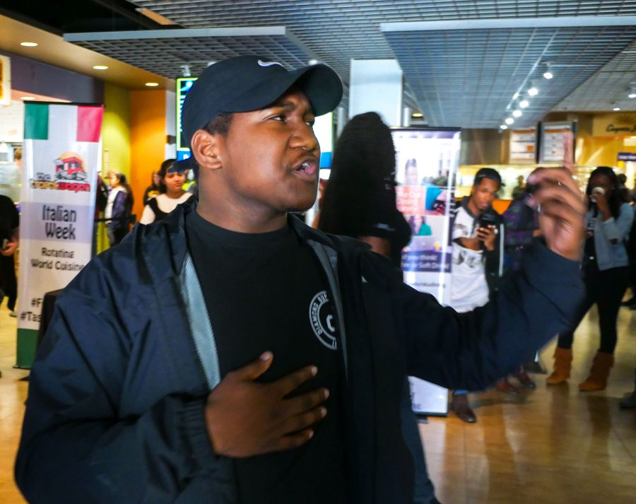 Trey Underwood stood in the entrance of the Student Union cafe. Underwood spoke on black beauty and culture.