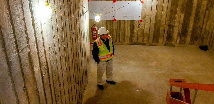 Project manager, Mark Jones gazes through a stairwell of Founder's Hall.