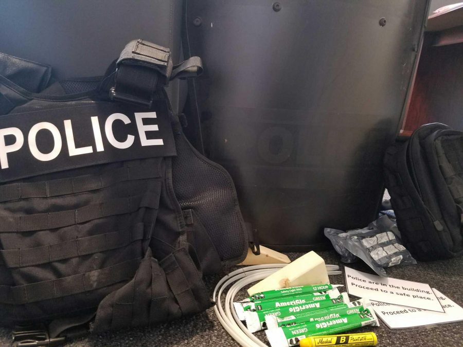 The NKU Police Department recently received new safety kits, which include glow sticks, zip ties, markers, door stoppers, cards reading 'Police are in the building. Proceed to a safe place' and bandages. NKU officers carry the kits in their vehicles along with a vest, shield, gun belt, ammunition, flashlight, notebook, handcuffs, baton and taser.