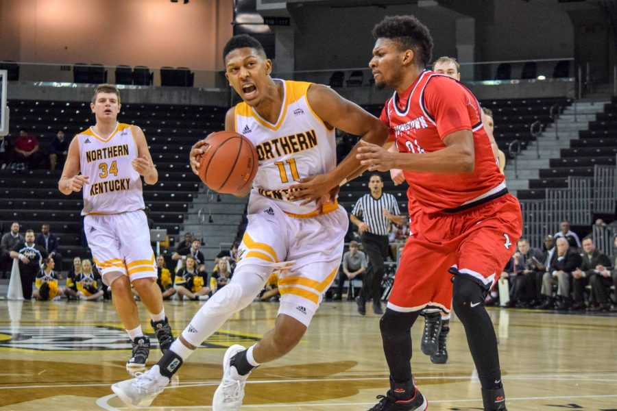 Mason Faulkner (11) drives to the basket during Thursday's win over Youngstown State.