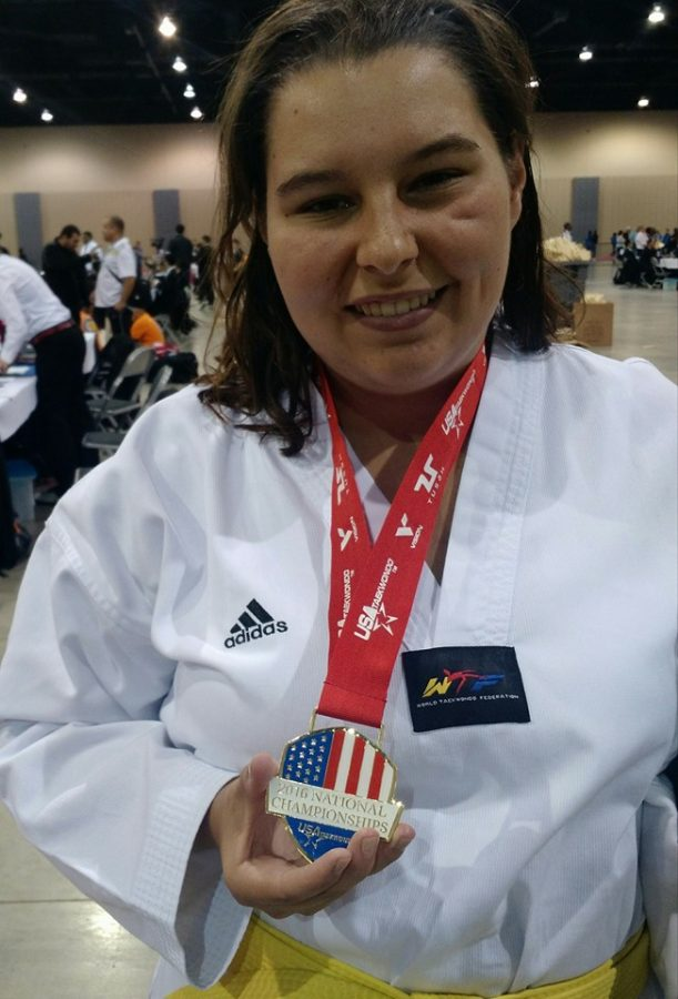 Clara Fightmaster receives a gold medal during the 2016 National Championship in Indiana.